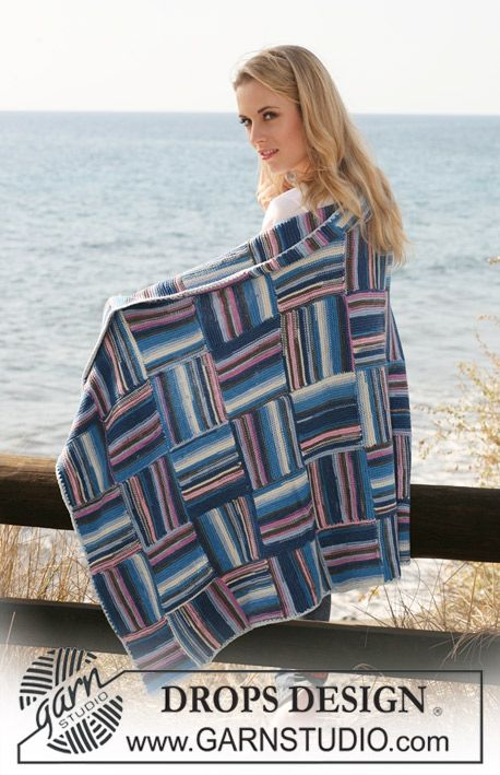 """DROPS blanket in garter st with interlaced squares in """"Muskat Soft""""."""