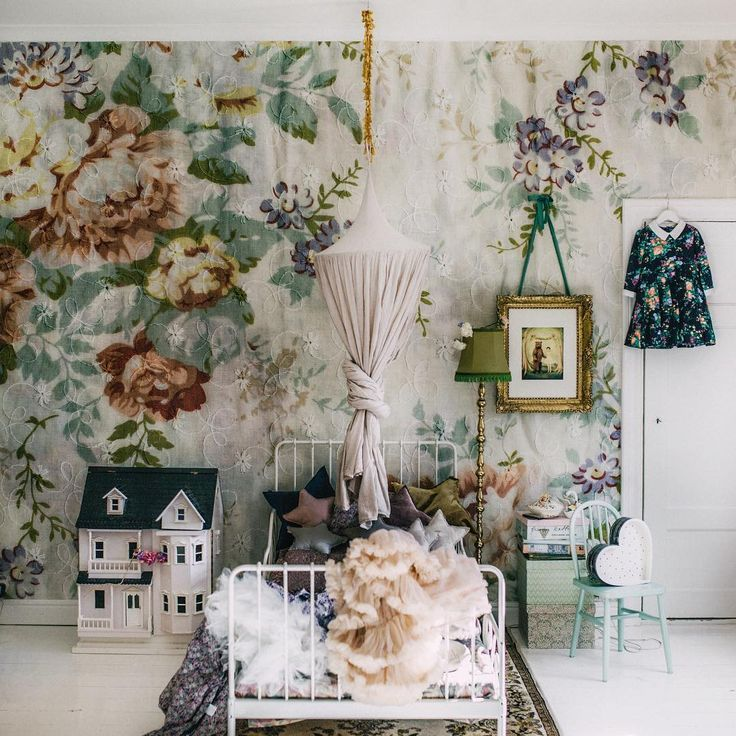 Vintage Girls room with canopy and floral wallpaper