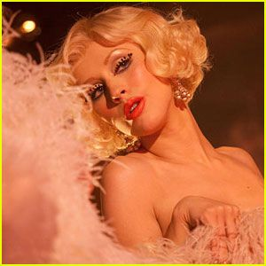 Burlesque is my new movie love!!  I, too, likes a guy what takes it sl....ooooow!