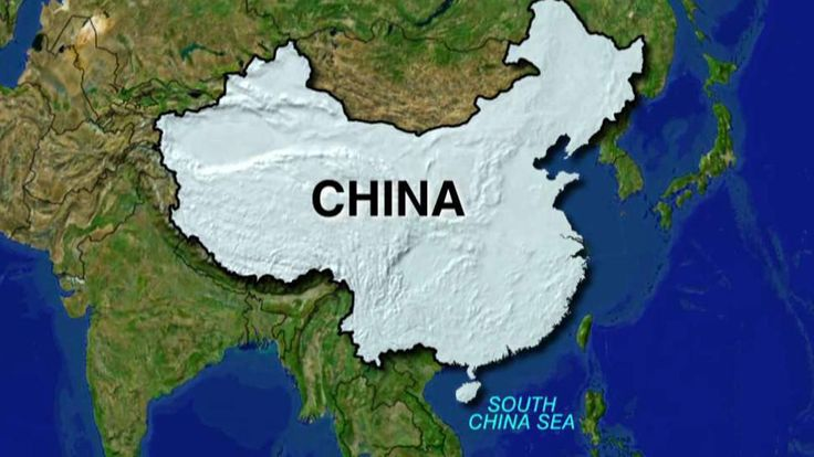 South China Sea: US Navy destroyer sails near man-made Chinese island official says