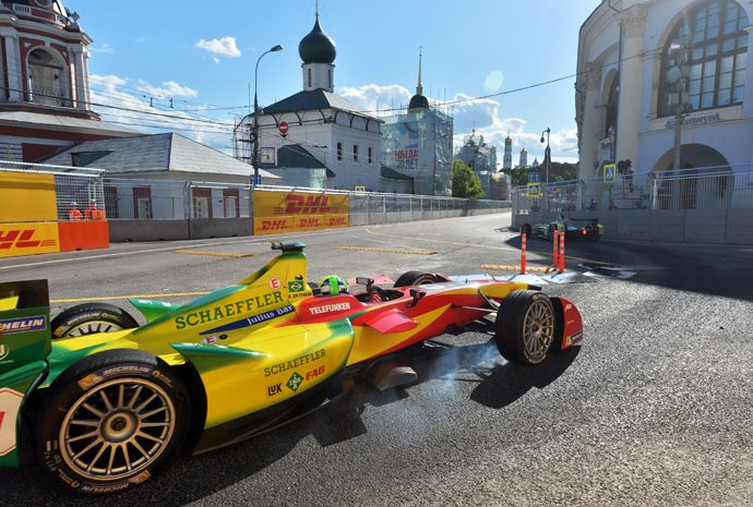 Going green: Formula E drivers power around Kremlin at 250km/h (VIDEO, PHOTOS) http://sumo.ly/8pa2 Lucas di Grassi of the Audi Sport Abt team during a race at the FIA Formula E Championship in Moscow. (RIA Novosti / Alexey Kudenko)