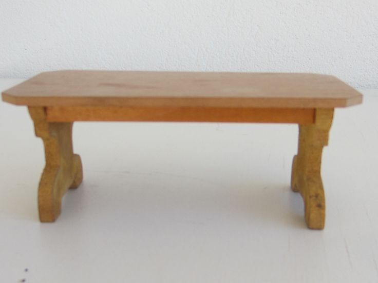 It came with a box of Schneegass furniture.. Is this little table by Schneegass?
