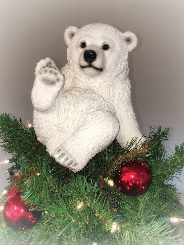 "7.75"" Real life Playing Polar Bear Sitting Christmas Tree Topper. This playful, real-life looking polar bear automatically will bring a touch of whimsy to your holidays! Measures approximately 7.75""H                                                                                                                                                                                  More"