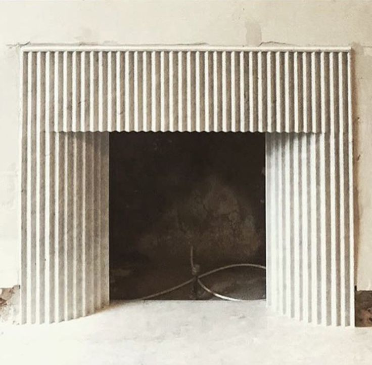 Decorative fluting on a fireplace inspired by ancient greece patterns and carvings