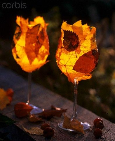 Leaves glued to the outside of the champagne glasses for Autumn dinner parties