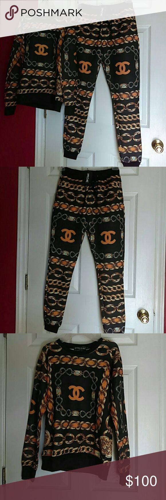 CHANEL Pant/Top Set Chanel Inspired  joggers with matching top...brand new! Tags attached...top and pants say a size small but fits like a medium...whether u like ur pants fitted or  loose you cannot go wrong with this outfit..This is a must have outfit for any occasion...wear with heels or wit sneakers..price firm CHANEL Other