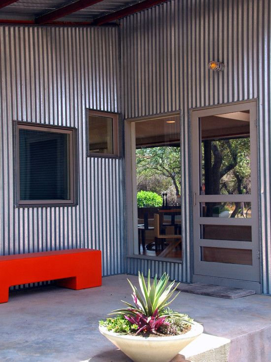 I would like to use corrugated steel siding, but it reminds me too much of a barn or an army quonset hut