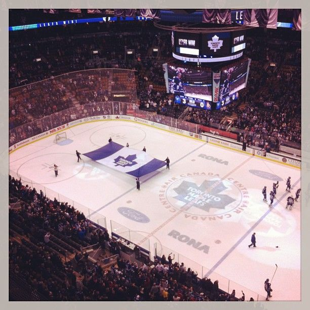 A giant Leafs flag on the ACC ice after the win