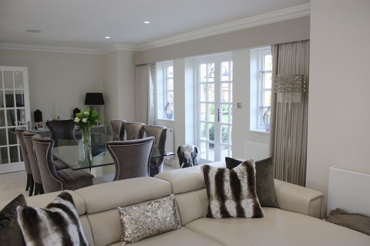 Contemporary classic interior featuring curtains and pelmets using Jane Churchill fabric, chairs by Kelly Hoppen and cushions made using Zinc faux furs.  A cool, calm interrior in greys, ivory and silver.