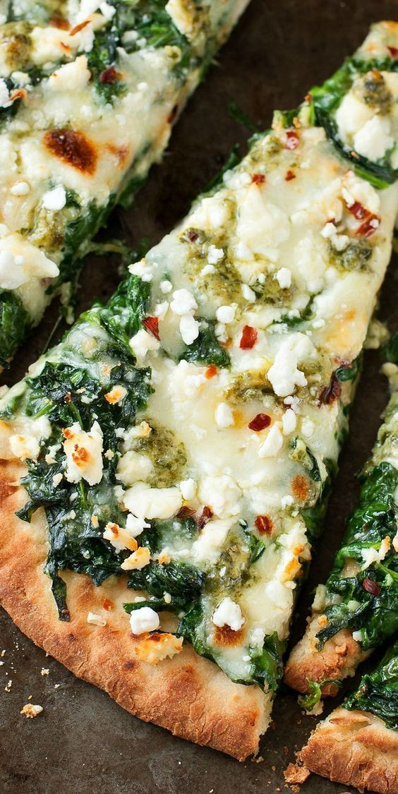 Three Cheese Pesto Spinach Flatbread Pizza :: Aiming to eat more veggies? This Three Cheese Pesto Spinach Flatbread Pizza packs an entire box of spinach into one gloriously cheesy single-serving pizza!