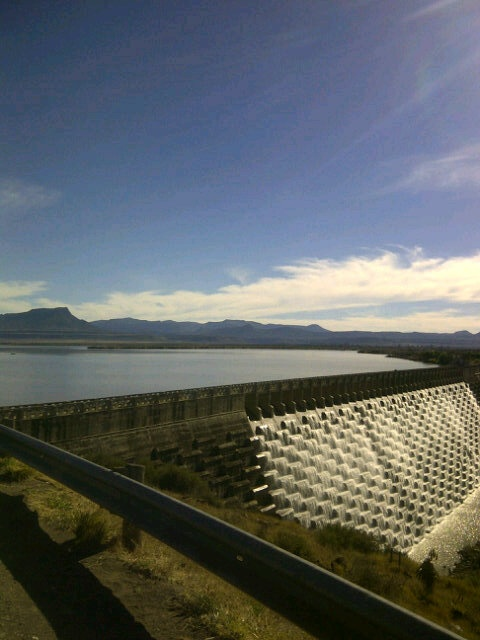 Melting snow ensures that the Nqweba Dam situated just outside of Graaff-Reinet keeps overflowing - amazing sight!!!    For more information on Nqweba Dam visit http://www.camdeboocottages.co.za/index.php/site-seeing/nqweba-dam    #travel #Karoo