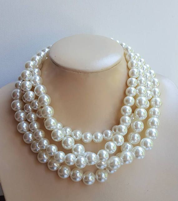 Check out this item in my Etsy shop https://www.etsy.com/ca/listing/526490660/chunky-pearl-bridal-necklace-large-ivory