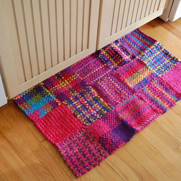 Woven rug from squares made on a potholder loom