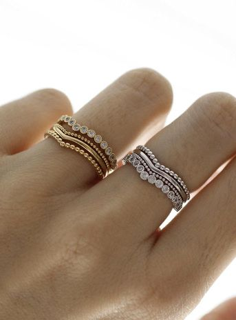 Stacking rings. is it weird that i love this for an engagement ring, wedding band and child band