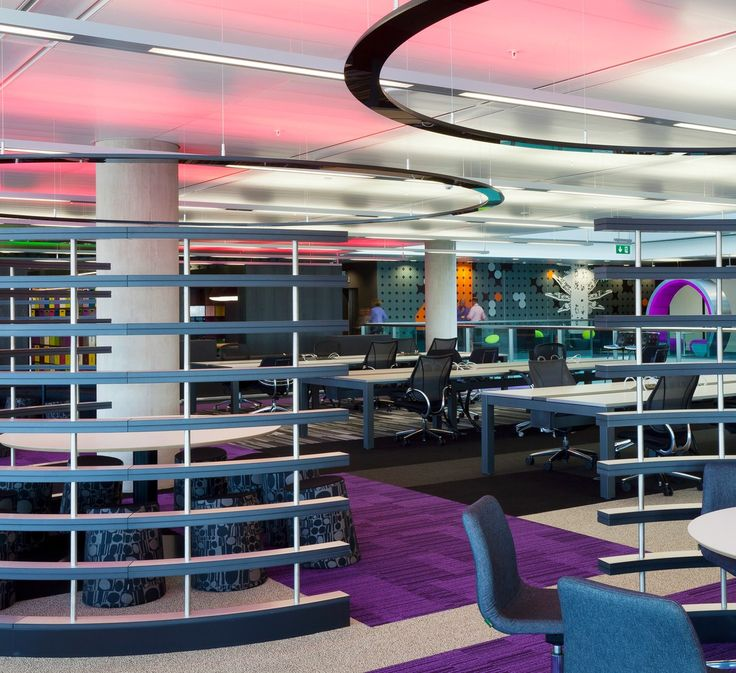 Bespoke curved joinery  in a ladder effect is used to create different work zones in this office fit out at BBC Media City in Salford, Manchester. The curves are echoed in the desk shapes, the ceiling design and the breakout seating. See more of this extensive office and media fit out on our website: