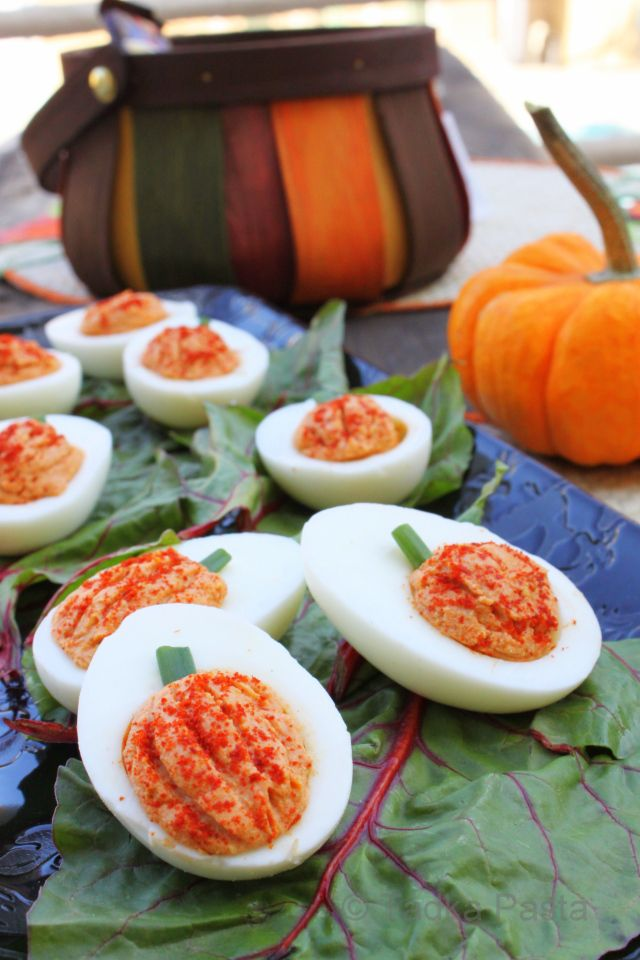 Healthy Halloween snack idea: Halloween deviled eggs shaped like pumpkins. Too clever!