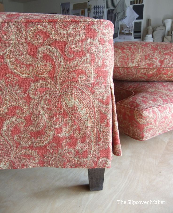 Ottoman slipcover with mock tailored skirt in paisley linen pattern Mariel Cliffside.