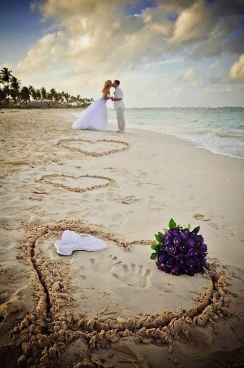 Not having a beach wedding-but maybe a picture like this needs to happen on the honeymoon :) (not in the wedding dress obviously) -repinned from LA officiant https://OfficiantGuy.com