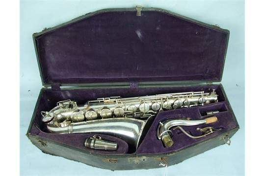 """Lot 380 - A silver-plated Adolphe saxophone engraved """"Medaille d'Or 1900, Adolphe Sax....84, Rue Myrha,"""