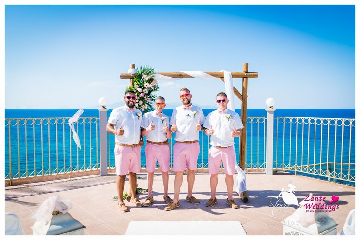 Pretty in pink! the groom and his groomsmen!