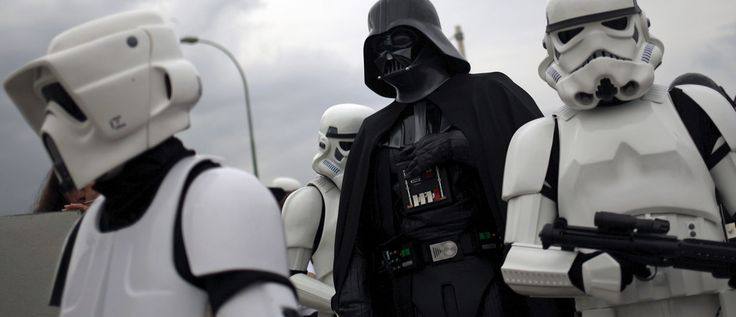 "Members of the 501st Legion Spanish Garrison dress up as ""Darth Vader"" (C) and ""Stormtroopers"" from the movie ""Star Wars"" during a solidarity parade to spread the message of bone marrow donation and the fight against cancer, organized by the Luis Olivares Foundation in downtown Malaga, southern Spain, October 24, 2015. REUTERS/Jon Nazca - RTX1T2GS"