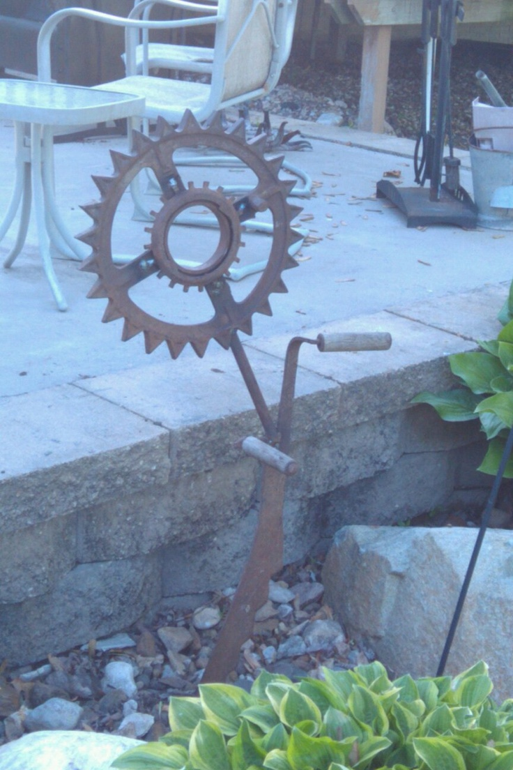 Flowers Made Out Of Tractor Parts : Flowers made out of old farm equipment gardening