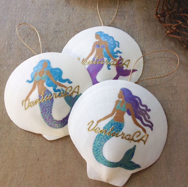 Hand painted Moon Clam Shell with a lovely shimmery Mermaid and Ventura, Ca in gold. Your choice of pink or white shell. Mermaid's are all going to be slightly different but very similar to the pictur