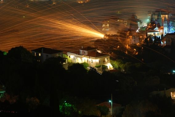 """The Chios Rocket War """"Rouketopolemos"""", in which two churches in the town of Vrontados shoot bottle rockets at each others' bell towers in a strange Easter celebration"""