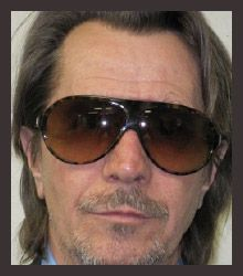 Gary Oldman wearing Entourage of 7.