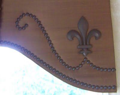 cornice board.. nail heads and fleur de lis