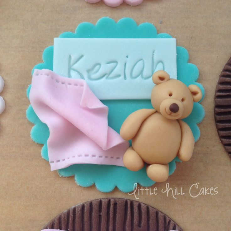 "Personalised cupcake topper for my 18 month old daughter featuring her favourite teddy bear and blanket. She pointed at it and said ""bear"", so I took it that it was a good likeness of her one! :-)"