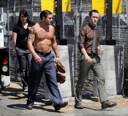 "Tom Hardy - Shirtless on the Inception set with JGL. Tom was still rocking his buffed body after having just finished filming ""Warrior"""