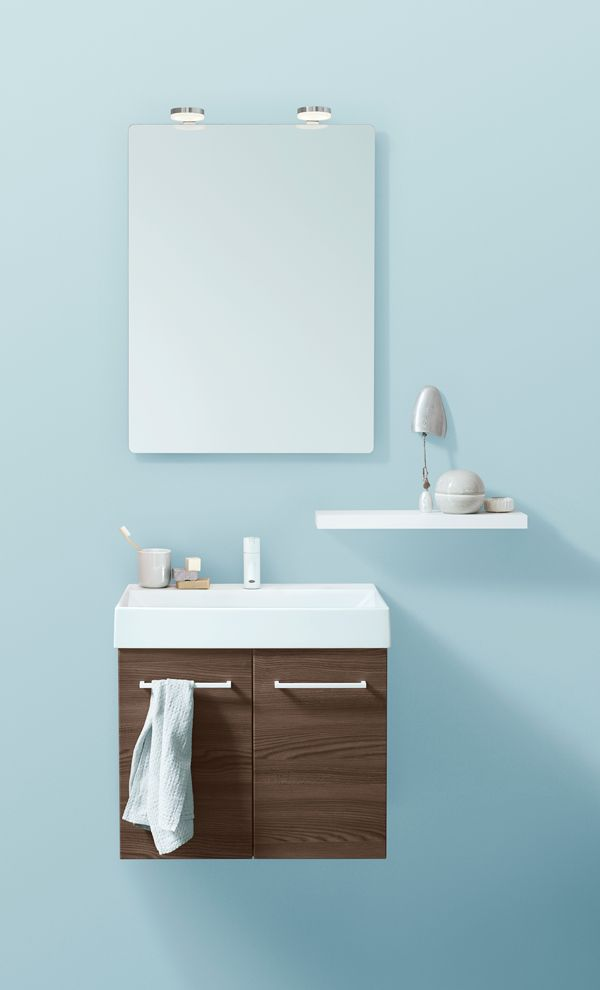 Small vanity unit with a twist. Mirror with stylish LED lights.