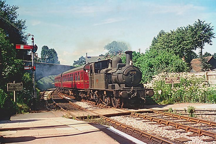 '1400' Class 0-4-2T 1471 is arriving at Tiverton Town station on the Exe Valley branch from Exeter on 26th July 1963.