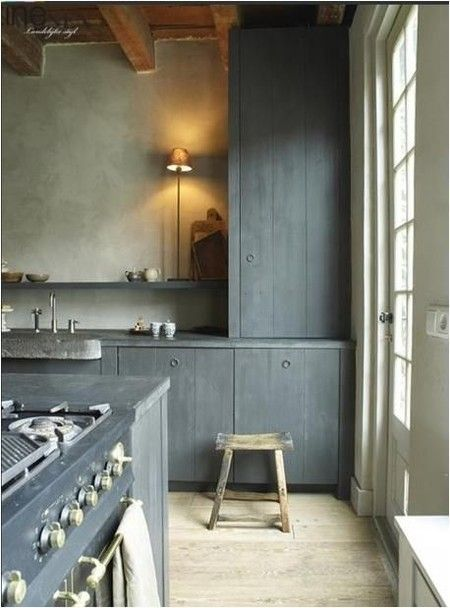 I love the over-sized door to let in light, and the wooden beams and high 'celiing'. Gives a real feeling of space.  Don't care for the colour scheme or kitchen cupboards though
