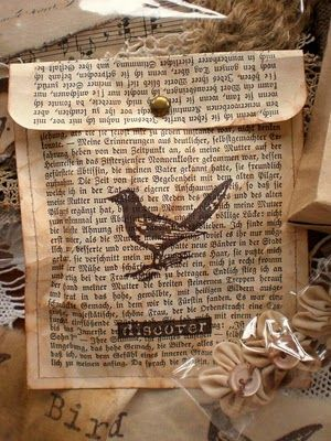 gift bags from old book pages and stamped. LOVE.