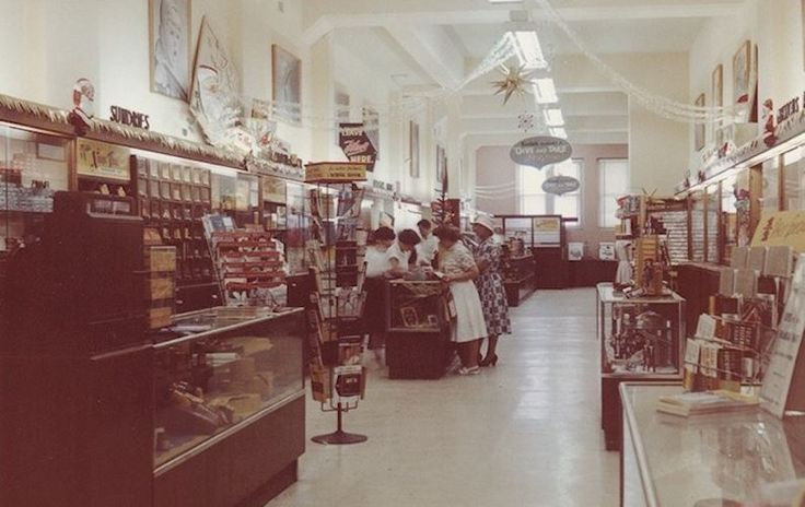 Colour photograph of the shop interior of the Kodak Australasia Pty Ltd retail store on Hay Street, Perth, Western Australia, circa 1960s. It shows customers at the service counter and Christmas decorations hung around the store.