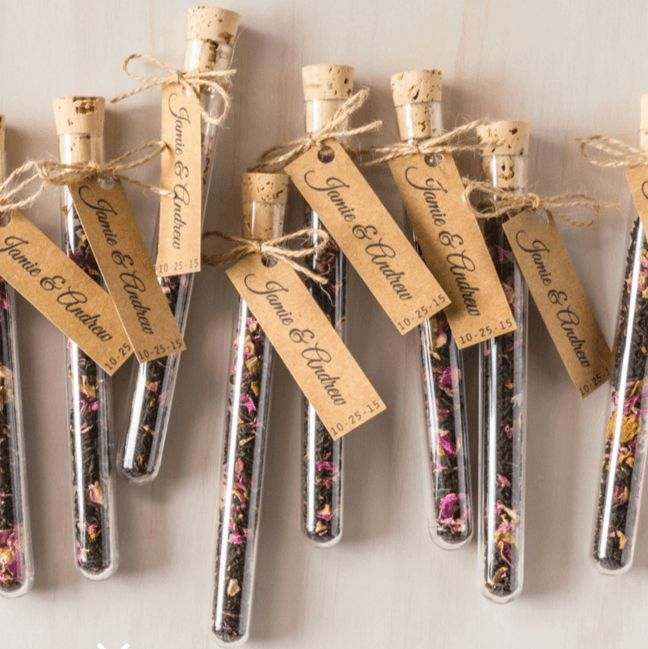 tea leaf favors in a clear test tube container.