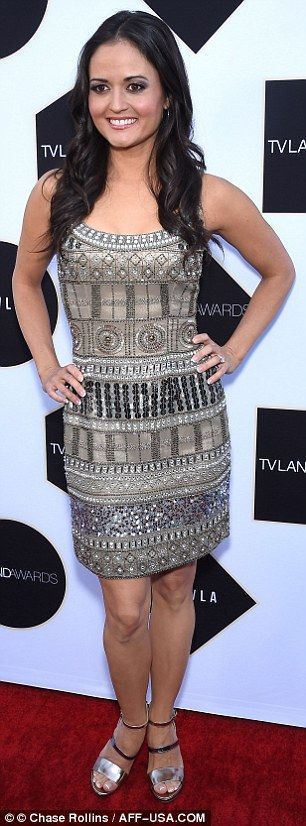 Glitter and glam: The 40-year-old actresssparkled in a metallic sequinned mini dress that...