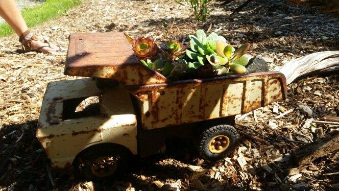 Tonka truck turned succulent garden