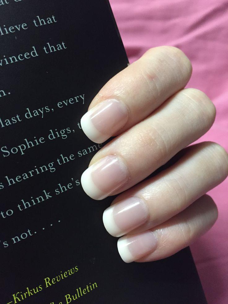 Natural acrylic nails.  American manicure. Natural French acrylic nails.