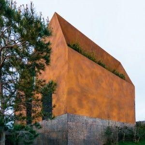 Portuguese studio Atelier Data designed Varatojo House in Lisbon which combines wood, concrete and cork facade