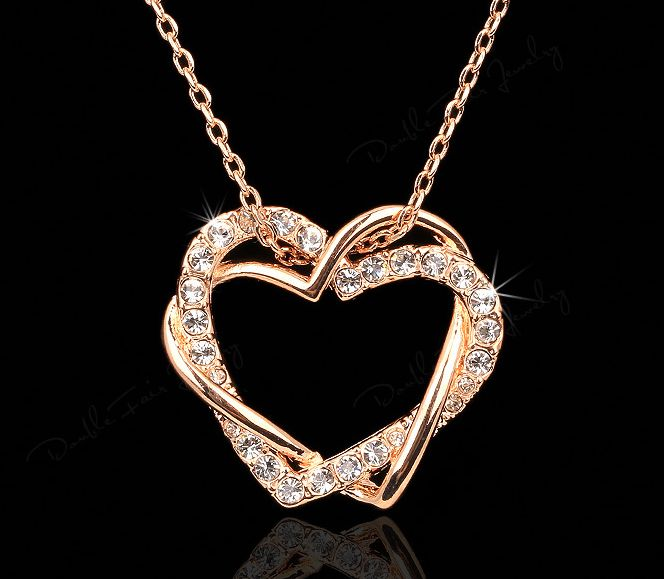 Two Hearts as One 18K Rose Gold Plated Hearts Necklace or 925 Sterling Silver Hearts Necklace. Beautiful hearts pendant necklace perfect for all romantics. Choose from .925 pure sterling silver or 18K