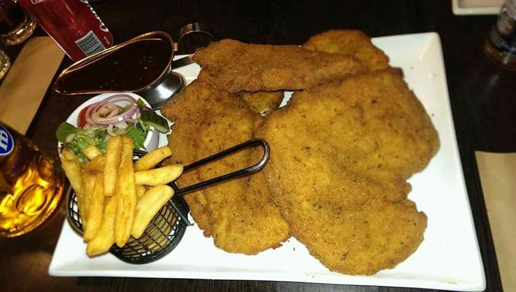 THE CHALLENGE   1kg of Schnitzel    Schnit house 260 Rundle Street Adelaide