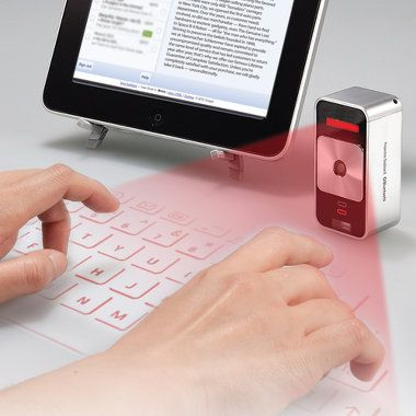 The Virtual Keyboard. This is the Bluetooth device that projects a laser- generated keyboard onto any flat, opaque surface, providing an instant keyboard for iPad, iPhone, or Android phone.