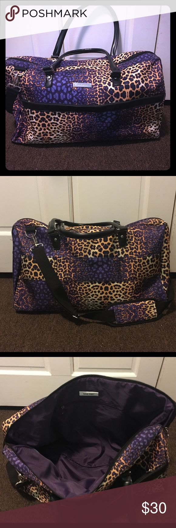 "Nine West Leopard Print Overnight/Weekender Bag This adorable leopard print bag is great for overnight, or even for a weekend away. It has soft material, so it can easily fit any need. The material is tough enough that it could be folded as an extra bag and checked full of souvenirs! It's in like new condition, used a few times, with no signs of wear or tear. It has two sturdy handles, as well as a tough detachable shoulder strap. It measures approximately 8"" wide, 21.5"" long, and 14.5""…"