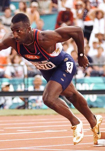 """Michael Johnson--This """"Man With the Golden Shoes"""" Set Us All On Fire As He Won the Record of """"The World's Fastest Man""""---A Fine Example of Sportsmanship On and Off The Track..."""