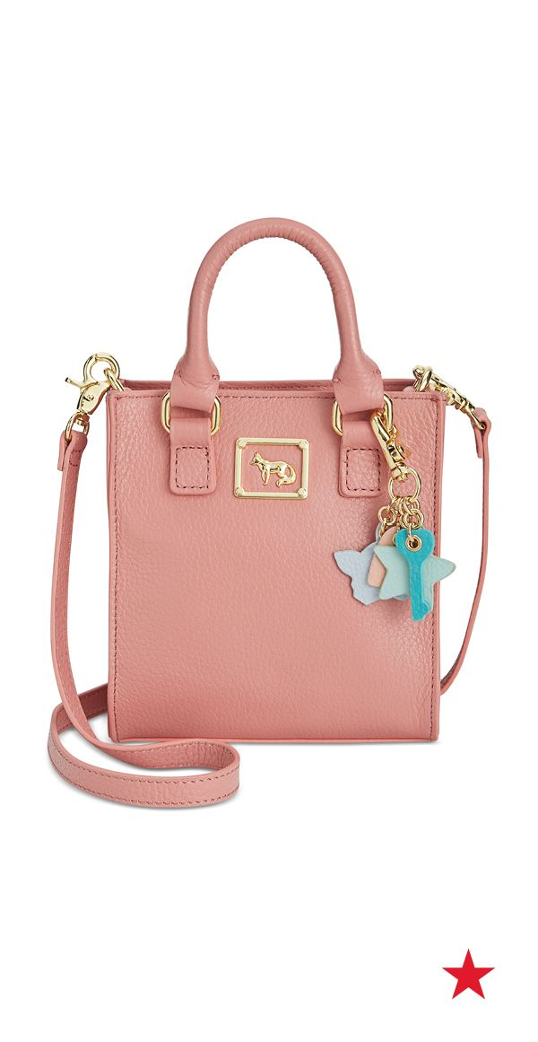We don't know what we love more about this adorable Emma Fox mini crossbody bag — the femme pop of pink or those cute charms?!