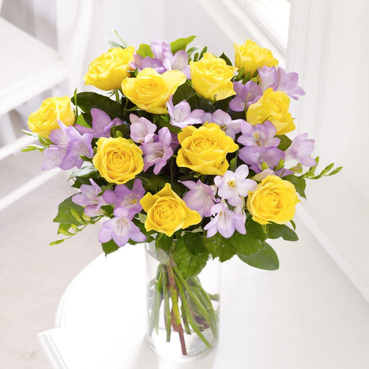 A Beautiful Gift Of Magical Yellow Roses And Soft Lilac Freesias