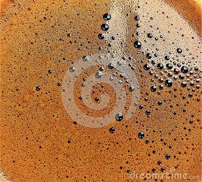 A shot the surface of a cup of coffee.